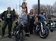 HOG members pose with their bikes.